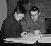 Оксана и Илья за работой. г.Москва, февраль 2004 года.