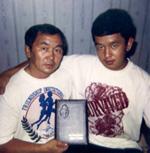 Болат с отцом после окончания колледжа, г. Кызыл, 1996 год. Капоэйра- традиционный бразильский уличный танец, с элементами боевых искусств.