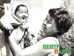 Happy mother with 6-month old younger son Aldar, 1983.